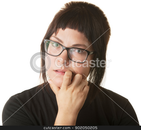 Woman biting her fingernails stock photo, Young Caucasian woman staring and biting her fingernail by Scott Griessel