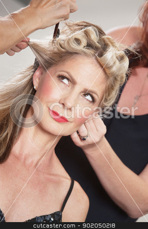 Confident Woman With Hair Sylists stock photo, Confident European woman with hair stylists working around her by Scott Griessel