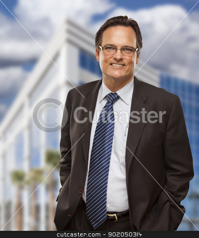 Handsome Businessman Smiling in Front of Building stock photo, Handsome Businessman in Suit and Tie Smiling Outside of Corporate Building. by Andy Dean