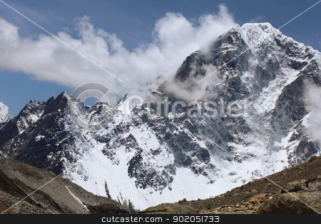 snowy mountains stock photo, High mountains against blue sky . Nepal. Everest by Sergey Nivens