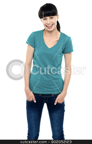Middle aged smiling woman in casual wear stock photo, Middle aged smiling woman in casual wear posing with hands in her pocket. by Ishay Botbol