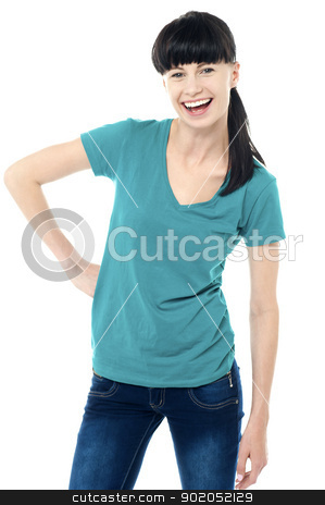 Trendy lady posing in style and flashing a smile stock photo, Trendy lady with one hand on hip flashing a smile. Isolated against white by Ishay Botbol