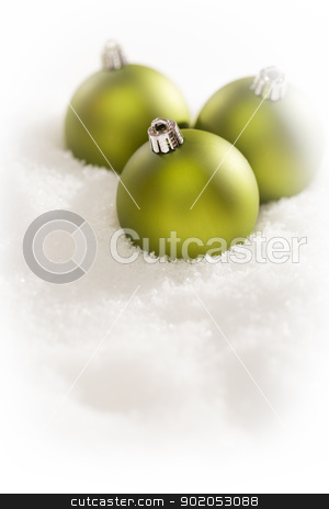 Green Christmas Ornaments on Snow Flakes with Text Room stock photo, Beautiful Matt Green Christmas Ornaments on Snow Flakes Room For Your Own Text. by Andy Dean