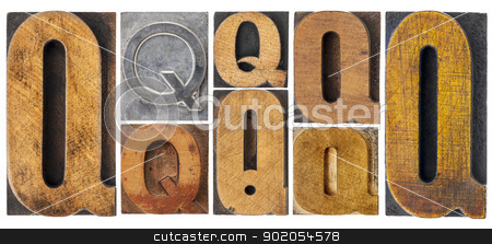 letter Q in wood type blocks stock photo, letter Q - 8 isolated vintage letterpress wood and metal type blocks with ink patina, variety of fonts by Marek Uliasz