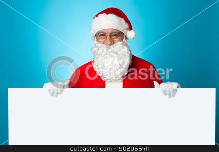 Use copy space area to promote your product stock photo, Use copy space area to promote your product. Santa holding blank ad board. by Ishay Botbol   