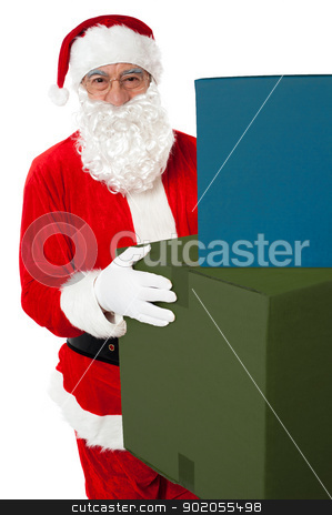 Photo of kind Santa Claus giving xmas presents stock photo, Photo of kind Santa Claus giving xmas presents and looking at camera by Ishay Botbol
