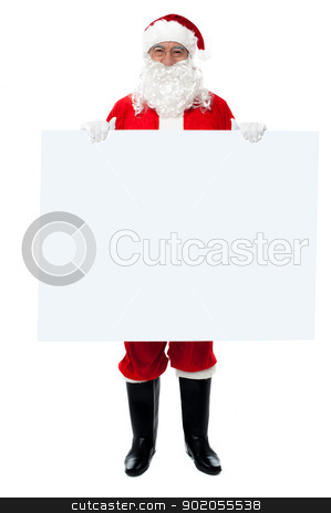 Saint Nicholas standing behind blank whiteboard stock photo, Full length portrait of Saint Nicholas standing behind blank whiteboard. by Ishay Botbol   