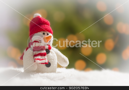 Cute Snowman Over Abstract Background stock photo, Cute Snowman Over Green and Gold Abstract Background. by Andy Dean