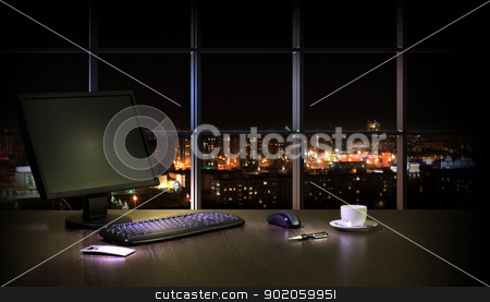 Office at night stock photo, Work place in the office at night with a city view from window by Sergey Nivens