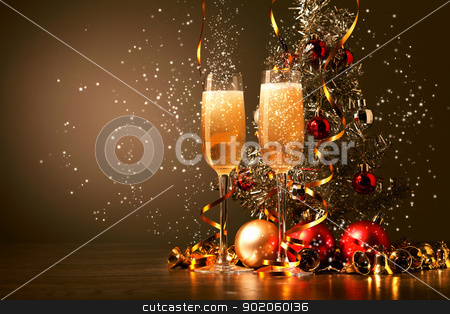 Glasses of champagne at new year party stock photo, Two champagne glasses ready to bring in the New Year by Sergey Nivens