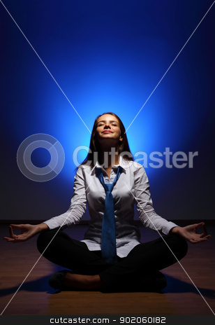 Business woman meditating stock photo, Young business woman sitting in asana lotus and meditating by Sergey Nivens