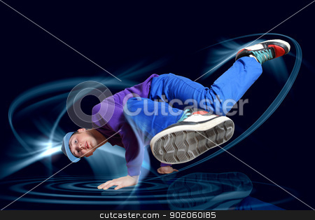 Modern style dancer stock photo, Modern style dancer posing against dark background with light effects. Illustration by Sergey Nivens