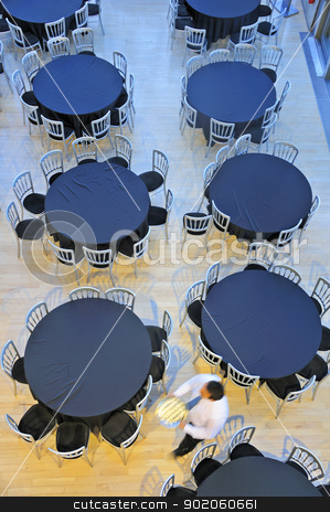 Empty tables stock photo, Overhead view of a restaurant with empty tables. A waiter passes, motion blur on the man. by Alistair Scott