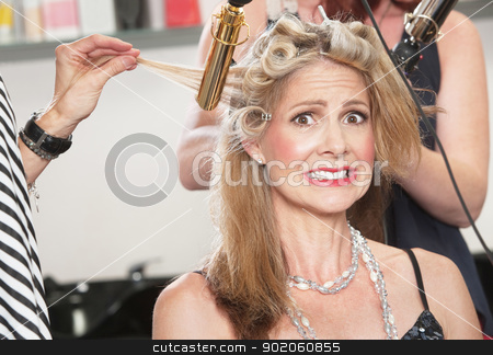 Anxious Woman with Hair Stylists stock photo, Anxious middle aged white woman with hair stylists working by Scott Griessel