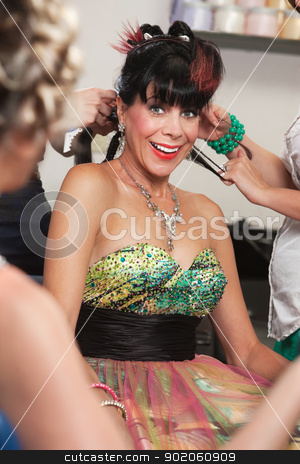 Excited Woman in Salon stock photo, Excited white woman with stylists working in salon by Scott Griessel