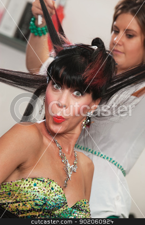 Lady in Salon Puckering Lips stock photo, Woman in hair salon puckering her lips by Scott Griessel