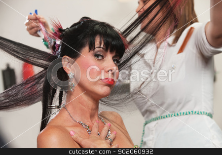 Pouting Lady in Salon stock photo, Pouting lady with hair straightened in hair salon by Scott Griessel