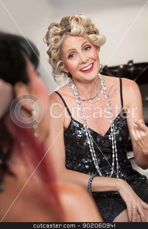 Women Talking in Hair Salon stock photo, Pair of stylish mature women talking in hair salon by Scott Griessel