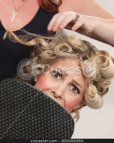 Frightened in Hair Salon stock photo, Frightened blond white female with mirror in hair salon by Scott Griessel