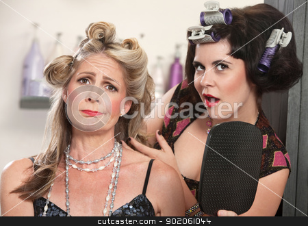 Sad Lady with Bad Hairdo stock photo, Sad mature woman with mirror and friend in curlers by Scott Griessel