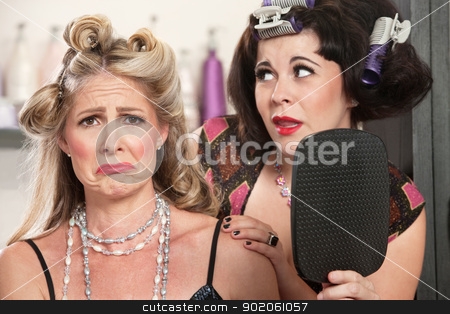 Pouting Lady in Bad Hairdo stock photo, Pouting woman with mirror and sympathetic friend by Scott Griessel