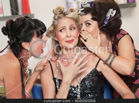 Ladies Gossiping in Salon stock photo, Happy friends in hair salon whispering to each other by Scott Griessel