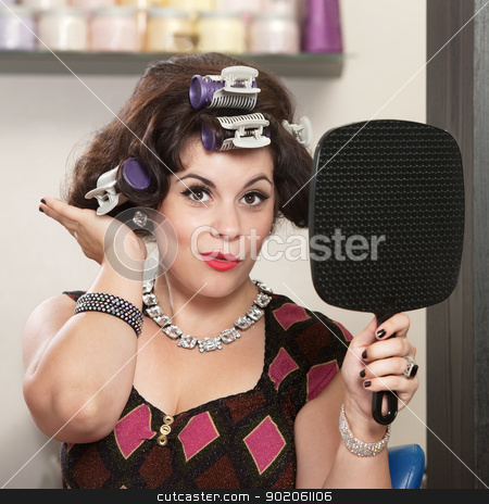 Lady Patting Her Hairdo stock photo, Happy woman in curlers patting her new hairdo by Scott Griessel