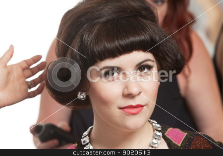 Woman With Hair Stylists stock photo, Calm young woman surrounded by hair stylists in salon by Scott Griessel