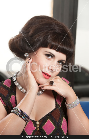 Lady in Diamond Necklace stock photo, Pretty Caucasian woman with diamond necklace and hand on chin by Scott Griessel