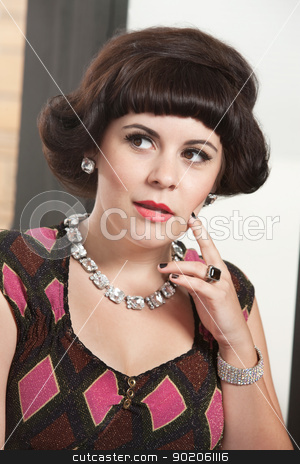 Woman with Finger on Chin stock photo, Curious young white female with finger on chin looking over by Scott Griessel