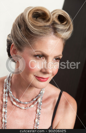 Woman with Fancy Hairdo stock photo, Beautiful mature white female with fancy hairdo by Scott Griessel