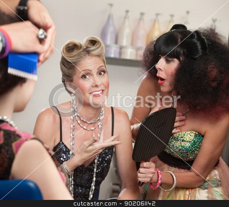 Relieved Lady and Friend in Hair Salon stock photo, Relieved woman with surprised friend in hair salon by Scott Griessel