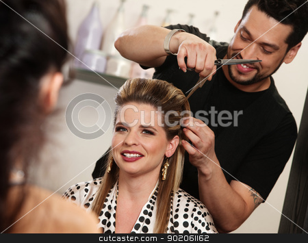 Happy Woman Getting Haircut stock photo, Smiling woman getting haircut by handsome hairdresser by Scott Griessel