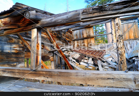 Old Decaying House stock photo, The decaying remains of an old abandoned home in the forest  located in the  California Sierra mountains. by Lynn Bendickson