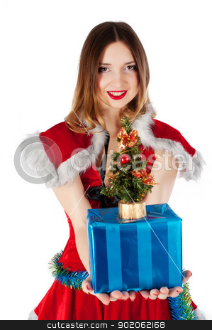 Beautiful and sexy christmas woman with gift stock photo, young beautiful Christmas woman with present, Focus on gift by Aikon
