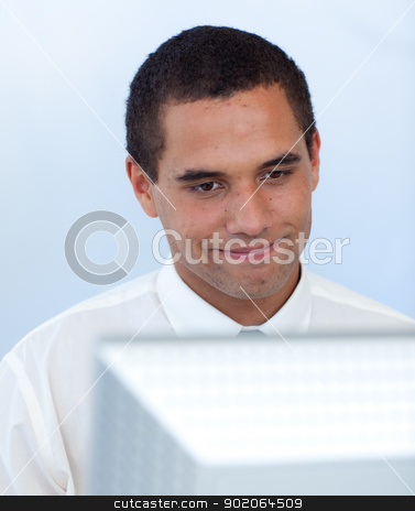 Businessman working with a computer stock photo, Businessman working with a computer in office by Wavebreak Media