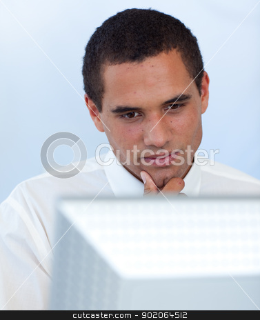 Thoughtful businessman working with a computer stock photo, Thoughtful businessman working with a computer in office by Wavebreak Media