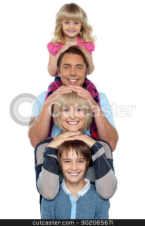 Attractive smiling family of four posing in a single line stock photo, Attractive smiling family of four posing in a single line isolated over white background. by Ishay Botbol   