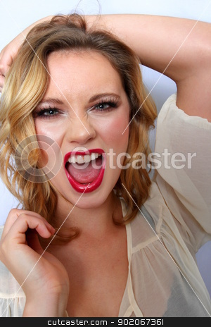 Blond Woman stock photo, Portrait of a blond woman white background. by Henrik Lehnerer