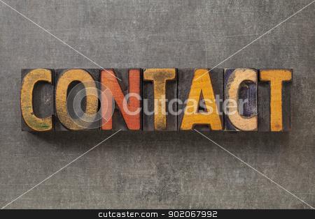 contact word in wood type stock photo, contact word in vintage letterpress wood type blocks against grunge metal background by Marek Uliasz