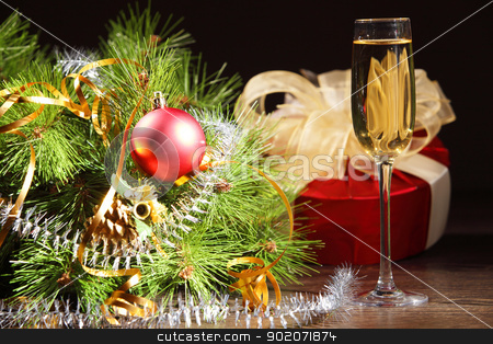 glass of champagne stock photo, glass of champagne and christmas decoration on the tavle for a new year eve by Sergey Nivens