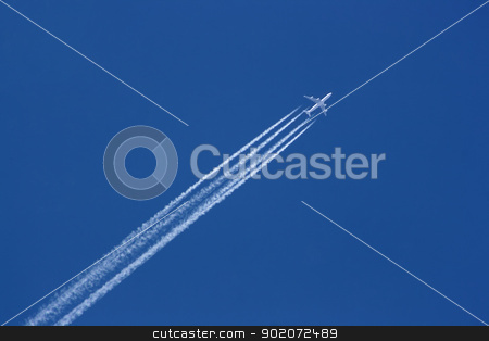 747 in air stock photo, Flight of Boeing 747 on clear blue sky with white trails behind by vaximilian