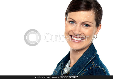 Attractively charming woman with a bright smile stock photo, Attractively charming woman with a bright smile. Copy space area towards left. by Ishay Botbol