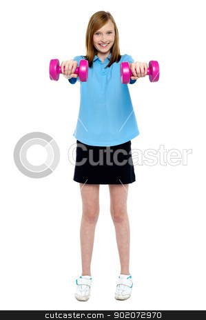 Slim girl striking a pose with dumbbells. Lifting weights stock photo, Slim girl striking a pose with dumbbells. Lifting weights. Full length studio shot. by Ishay Botbol