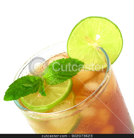 Iced Tea stock photo, Mint leaf and lime slice on the top of iced tea (Selective Focus, Focus on the mint leaf and the lime slice on the glass rim) by Ildiko Papp