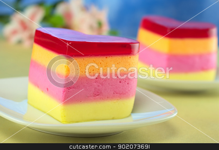 Peruvian Jelly Cake stock photo, Colorful Peruvian heart-shaped jelly-pudding cakes called Torta Helada with inca lily in the back (Selective Focus, Focus on the front of the first cake) by Ildiko Papp