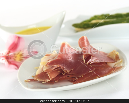 Ham Slices stock photo, Thin ham slices with asparagus and Hollandaise sauce in the back (Selective Focus, Focus on the front of the ham) by Ildiko Papp