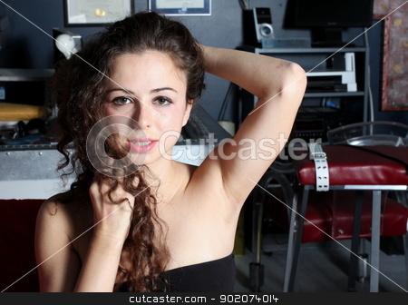 Brunette Woman stock photo, Portrait of a brunette woman in an dark office space. by Henrik Lehnerer
