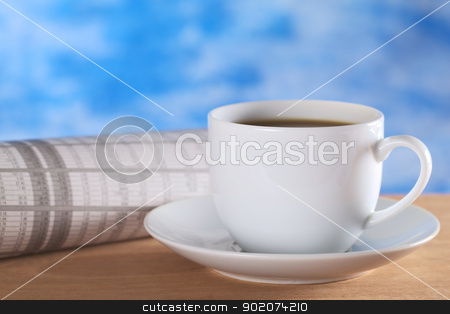 Coffee and Newspaper stock photo, Hot coffee with newspaper (stock market section) and blue background (Selective Focus, Focus on the front of the coffee cup) by Ildiko Papp
