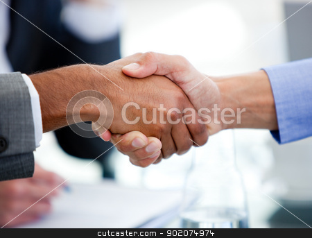 Close-up of business partners shaking hands stock photo, Close-up of business partners shaking hands in a meeting by Wavebreak Media